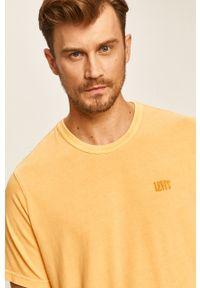 Żółty t-shirt Levi's® w kolorowe wzory, z okrągłym kołnierzem