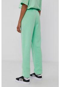 adidas Originals - Spodnie. Kolor: zielony. Materiał: bawełna, poliester