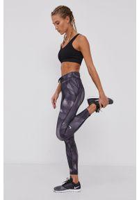 Nike - Legginsy. Kolor: szary. Materiał: dzianina, materiał, tkanina, włókno, skóra. Technologia: Dri-Fit (Nike)