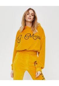 JOANNA MUZYK - Aksamitna bluza z kapturem i logo. Typ kołnierza: kaptur. Kolor: żółty. Materiał: dresówka, materiał, bawełna