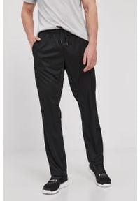 Reebok - Spodnie. Kolor: czarny. Materiał: materiał, tkanina, poliester. Wzór: gładki #1