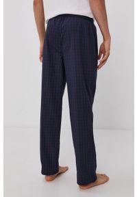 BOSS - Boss - Spodnie piżamowe. Kolor: fioletowy. Materiał: bawełna, tkanina