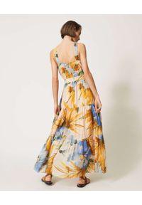 TwinSet - TWINSET - Sukienka maxi z kwiatowym wzorem Hamal. Typ kołnierza: dekolt w kształcie V. Kolor: niebieski. Materiał: bawełna. Długość rękawa: na ramiączkach. Wzór: kwiaty. Sezon: lato. Styl: wakacyjny. Długość: maxi