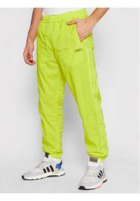 Żółte spodnie dresowe Adidas