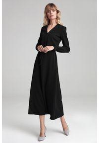e-margeritka - Sukienka maxi z długim rękawem czarna - 42. Okazja: do pracy. Kolor: czarny. Materiał: poliester, wiskoza, materiał, elastan. Długość rękawa: długi rękaw. Styl: elegancki. Długość: maxi