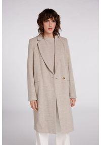 Beżowy wełniany płaszcz Oui. Kolor: beżowy. Materiał: wełna