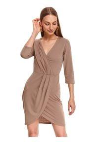 TOP SECRET - Sukienka damska gładka. Typ kołnierza: dekolt w kształcie V. Kolor: beżowy. Materiał: materiał. Wzór: gładki. Typ sukienki: proste. Styl: elegancki