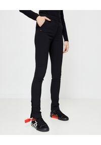 OFF-WHITE - Czarne spodnie z guzikami. Kolor: czarny. Materiał: materiał. Wzór: aplikacja
