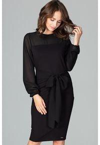 Lenitif - Elegancka sukienka z półprzezroczystą górą i rękawami czarna. Typ kołnierza: kokarda. Kolor: czarny. Długość rękawa: długi rękaw. Styl: elegancki