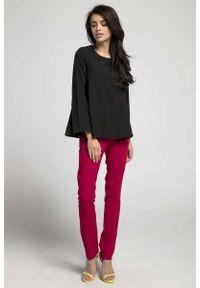 Czarna bluzka z długim rękawem Nommo z dekoltem na plecach