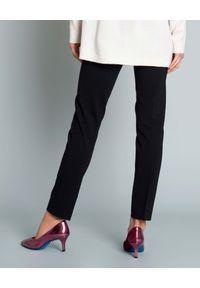 SEDUCTIVE - Czarne spodnie w kant. Kolor: czarny. Materiał: guma. Styl: elegancki