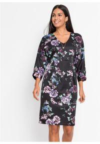 Sukienka ze stretchem, kimonowe rękawy bonprix czarny z nadrukiem. Typ kołnierza: dekolt w serek. Kolor: czarny. Materiał: materiał, poliester, elastan. Wzór: nadruk. Typ sukienki: dopasowane. Styl: elegancki