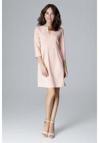Lenitif - Elegancka sukienka z podwyższoną talią dekolt V różowa. Okazja: do pracy. Kolor: różowy. Styl: elegancki