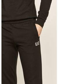 Czarne spodnie dresowe EA7 Emporio Armani z aplikacjami