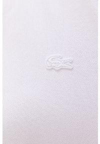 Lacoste - EF5473. Kolor: biały. Materiał: dzianina, materiał. Długość rękawa: krótki rękaw. Wzór: gładki. Typ sukienki: dopasowane