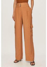 Silvian Heach - Spodnie. Stan: podwyższony. Kolor: pomarańczowy. Materiał: tkanina