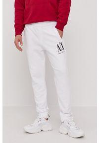 Armani Exchange - Spodnie. Kolor: biały