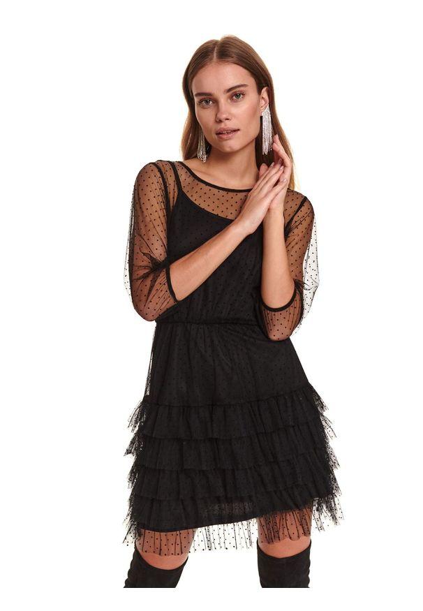 TOP SECRET - Tiulowa sukienka z falbaną i gumą w pasie. Okazja: na imprezę. Kolor: czarny. Materiał: tiul, guma. Wzór: aplikacja. Sezon: zima