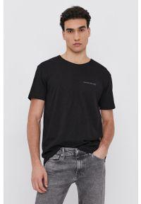 Calvin Klein Jeans - T-shirt bawełniany. Okazja: na co dzień. Kolor: czarny. Materiał: bawełna. Wzór: nadruk. Styl: casual