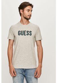 Szary t-shirt Guess Jeans casualowy, z okrągłym kołnierzem, z nadrukiem