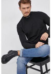 Calvin Klein Jeans - Longsleeve. Okazja: na co dzień. Kolor: czarny. Materiał: bawełna, dzianina. Długość rękawa: długi rękaw. Wzór: gładki. Styl: casual