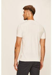 Guess Jeans - T-shirt. Kolor: biały. Materiał: jeans. Wzór: nadruk