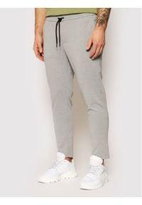 Jack & Jones - Jack&Jones Spodnie dresowe Will 12189819 Szary Regular Fit. Kolor: szary. Materiał: dresówka