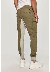 Oliwkowe spodnie Desigual gładkie