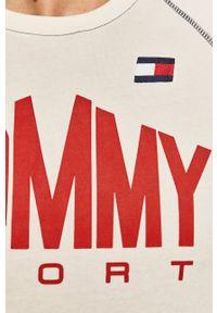 Tommy Sport - T-shirt. Okazja: na co dzień. Kolor: biały. Materiał: dzianina. Wzór: nadruk. Styl: sportowy