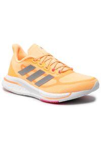 Adidas - Buty adidas - Supernova + W FX6701 Aciora/Silvmt/Scrpnk. Kolor: pomarańczowy. Materiał: materiał. Szerokość cholewki: normalna. Sport: bieganie