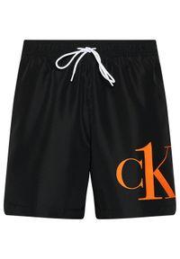Calvin Klein Swimwear Szorty kąpielowe Medium Drawstring KM0KM00590 Czarny Regular Fit. Kolor: czarny