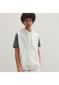 Kremowa bluza Reserved z kapturem