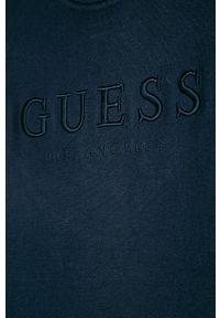 Niebieski sweter Guess Jeans z aplikacjami, z okrągłym kołnierzem