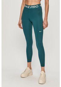 Nike - Legginsy. Kolor: zielony. Materiał: tkanina, dzianina, skóra, włókno. Technologia: Dri-Fit (Nike)