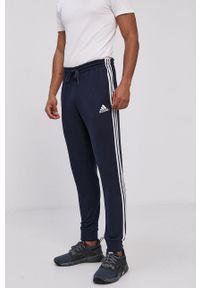 Adidas - adidas - Spodnie. Okazja: na co dzień. Kolor: niebieski. Materiał: dzianina, bawełna. Styl: casual