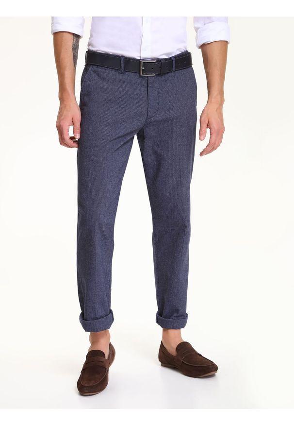 Niebieskie spodnie TOP SECRET w kolorowe wzory, casualowe