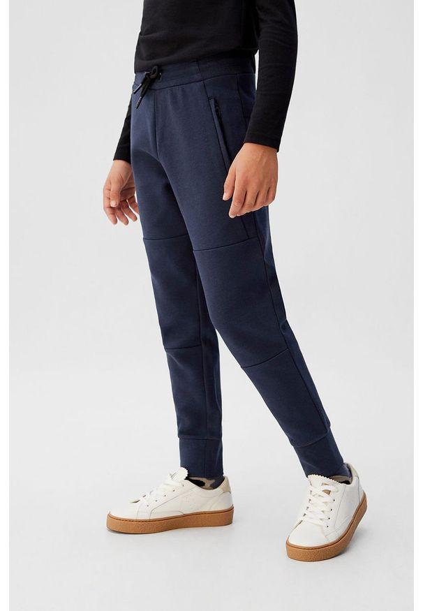 Niebieskie spodnie dresowe Mango Kids
