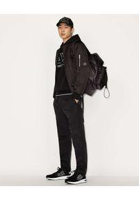Armani Exchange - ARMANI EXCHANGE - Czarna bluza z odblaskowym logo. Kolor: czarny. Materiał: materiał. Długość rękawa: długi rękaw. Długość: długie. Wzór: nadruk