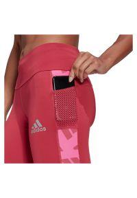 Adidas - Legginsy do biegania adidas Own The Run Celebration GK5068. Materiał: włókno, poliester, materiał, elastan. Długość: długie. Sport: bieganie