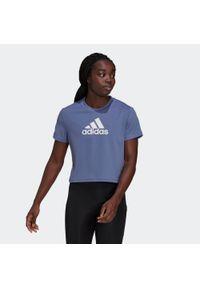 Koszulka fitness damska Adidas. Materiał: skóra, materiał, poliester. Długość: krótkie. Sport: fitness