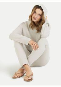 Miętowe bawełniane spodnie dresowe Juvia. Kolor: miętowy. Materiał: bawełna, dresówka