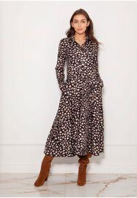 e-margeritka - Sukienka koszulowa długa elegancka w panterkę - 38. Okazja: do pracy. Materiał: materiał, poliester. Długość rękawa: długi rękaw. Wzór: motyw zwierzęcy. Typ sukienki: koszulowe. Styl: elegancki. Długość: maxi