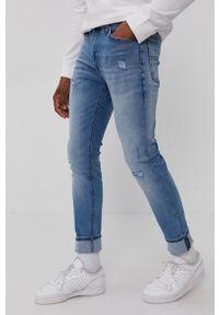 Tommy Jeans - Jeansy Simon. Kolor: niebieski