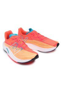 New Balance - Buty NEW BALANCE - REBEL WFCXLM2 Pomarańczowy Różowy. Kolor: pomarańczowy, wielokolorowy, różowy. Materiał: materiał. Szerokość cholewki: normalna