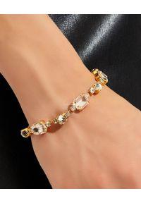 CAROLINE SVEDBOM - Bransoletka z kryształami Corinna. Materiał: złote. Kolor: złoty. Wzór: aplikacja. Kamień szlachetny: kryształ