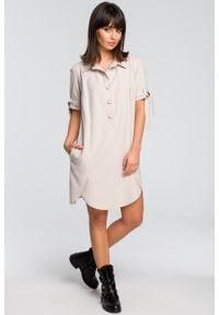 e-margeritka - Sukienka koszulowa na guziki beżowa - 40. Okazja: na co dzień. Kolor: beżowy. Materiał: poliester, len, materiał. Długość rękawa: krótki rękaw. Typ sukienki: koszulowe. Styl: elegancki, casual. Długość: midi