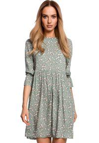 MOE - Rozkloszowana krótka sukienka oversize na lato. Materiał: tkanina. Wzór: kwiaty, nadruk. Sezon: lato. Typ sukienki: oversize. Długość: mini
