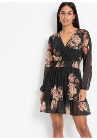 Sukienka z falbaną bonprix czarny w kwiaty. Kolor: czarny. Wzór: kwiaty. Styl: elegancki