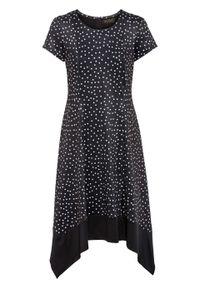 Sukienka z dżerseju, krótki rękaw bonprix czarno-biały w kropki. Kolor: czarny. Materiał: jersey. Długość rękawa: krótki rękaw. Wzór: kropki. Typ sukienki: asymetryczne