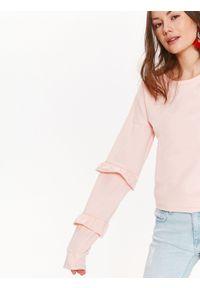 Różowa bluzka TROLL z falbankami, casualowa